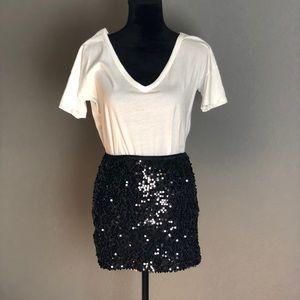 Stretch sequin mini skirt.